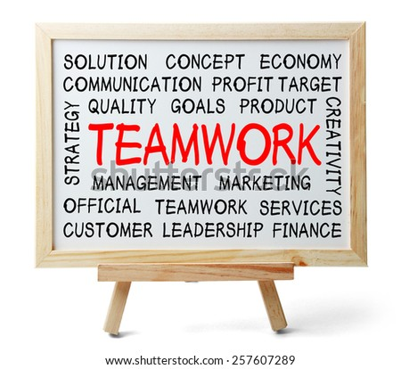 Teamwork word cloud is written on a whiteboard which is isolated on white background. - stock photo