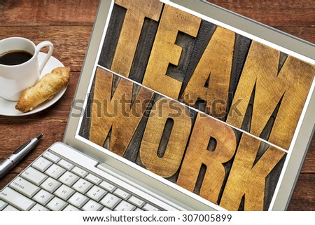 teamwork word typography - letterpress wood type printing blocks on a laptop screen with a cup of coffee - stock photo