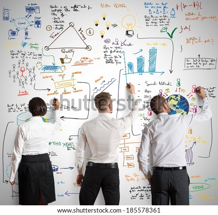 Teamwork works together for a new business project - stock photo