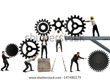 Teamwork works together to build a gear system - stock photo