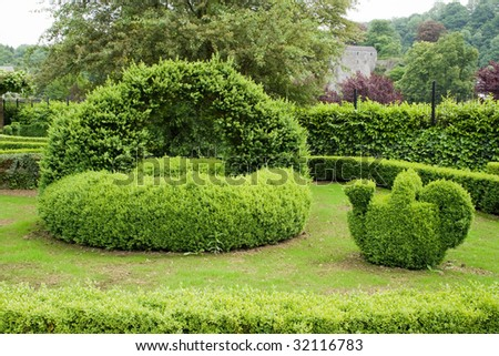 Teapot and basket from structured Topiary park Durbui, Belgium