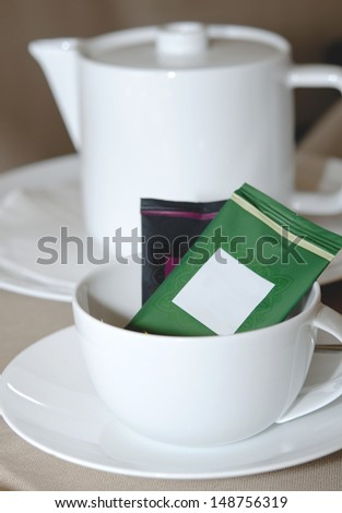 Teapot and cup - stock photo