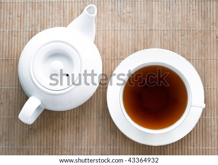 teapot and cup on a wooden tray. top view - stock photo