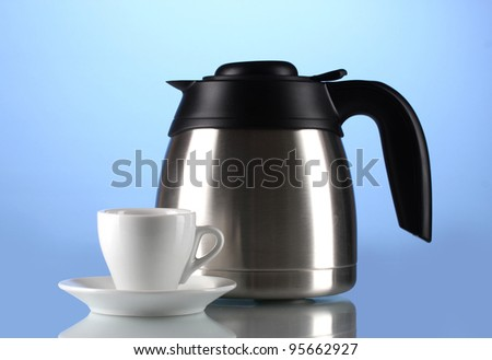 Teapot and cup on blue background - stock photo