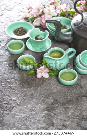 Teapot and cups on stone table. Traditional chinese tea ceremony. Asia style still life - stock photo