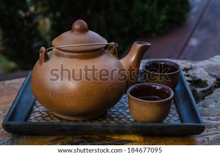 Teapot and cups on table - stock photo