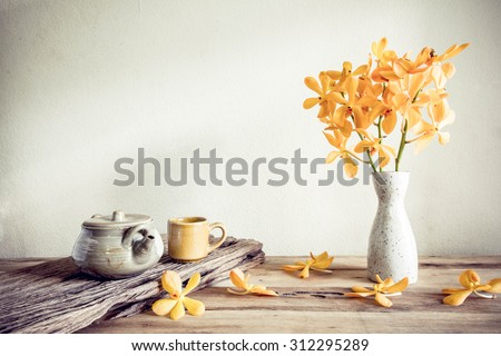 teapot and flower home decoration concept