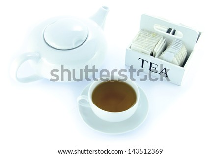 Teapot and teacup with a set of tea bags