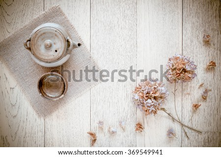 Teapot, cups a wooden background, top view. Vintage Style - stock photo