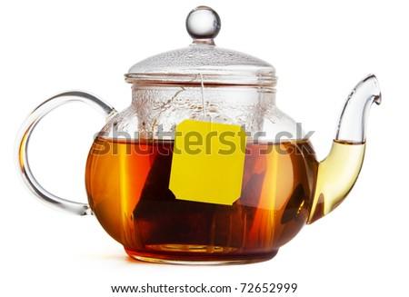 Teapot of hot black tea on white background - stock photo