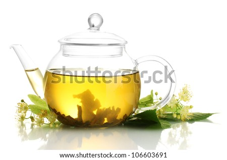 teapot of linden tea and flowers isolated on white - stock photo