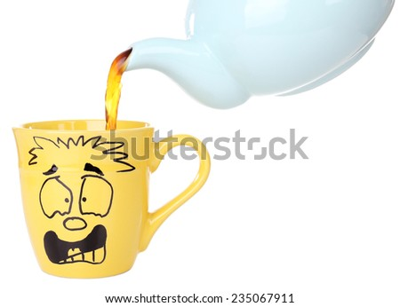 Teapot pouring tea into emotional cup, isolated on white - stock photo