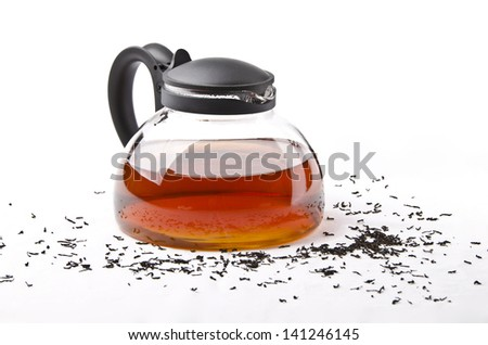 teapot with black tea - stock photo