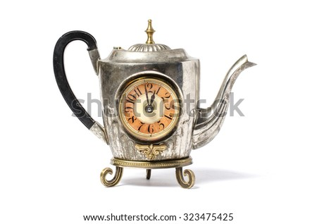 Teapot with clock isolated on white - stock photo