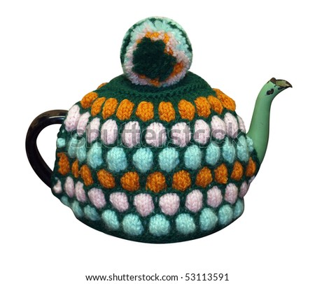 Teapot with knitted cosy isolated with clipping path - stock photo