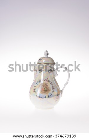 teapot with picture and floral ornate on white