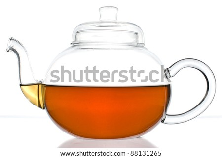 Teapot with some tea inside on a white background - stock photo