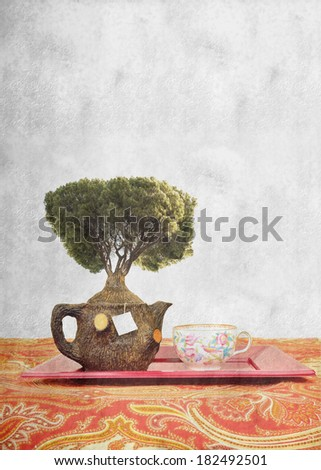 teapot wood, a tree, and cup healthy concept background with copy space for text - stock photo