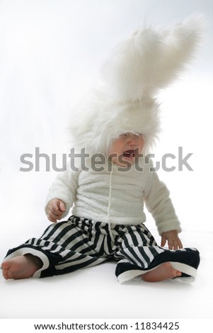 Tearful Boy in a white downy bunny costume.