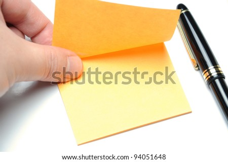 Tearing adhesive note - stock photo