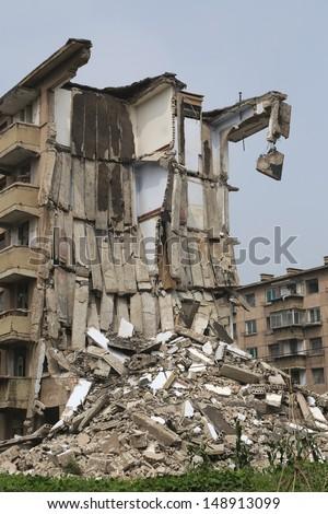 tearing down concrete buildings  - stock photo