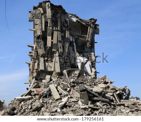 tearing down concrete buildings  - stock photo