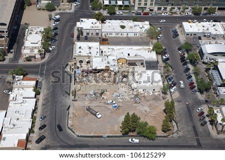 Tearing down nightclub for new clubs and condos - stock photo