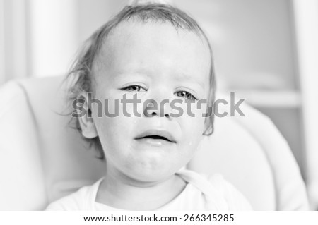 tears of baby girl at the home - stock photo
