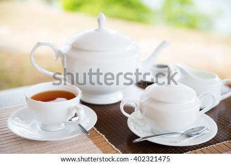 teatime, drink and object concept - close up of tea service on table at restaurant or teahouse - stock photo