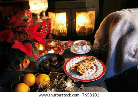 Teatime place in winter with fire and food - stock photo