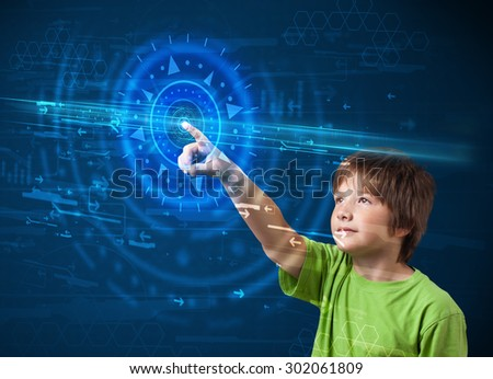 Tech boy pressing high technology control panel screen concept - stock photo