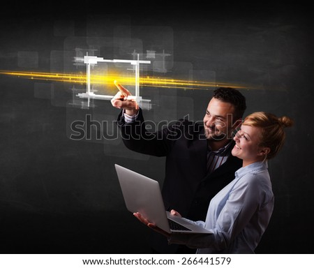 Tech couple touching button with orange light beams concept  - stock photo