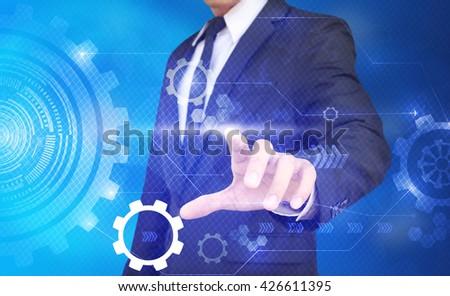 Tech guy pressing high technology control panel screen concept - stock photo