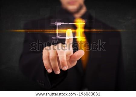 Tech person touching button with orange light beams concept  - stock photo