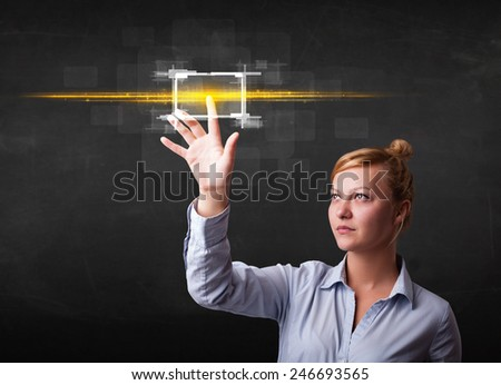 Tech woman touching button with orange light beams concept  - stock photo