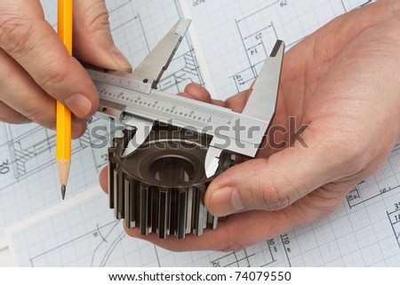 technical drawing and tools in hand - stock photo