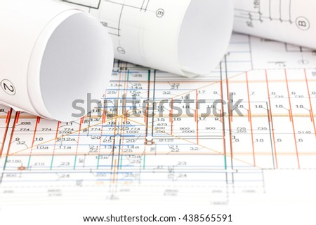 technical drawing detail and rolls of floor plan blueprints - stock photo
