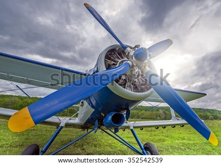 Technical service of the old retro plane before the flight. - stock photo