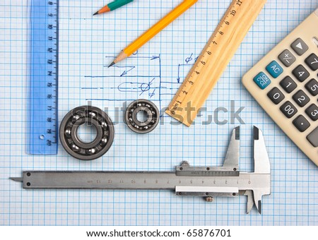 technical tools on a background of graph paper - stock photo