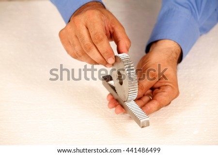 technical tools with hands and back ground - stock photo