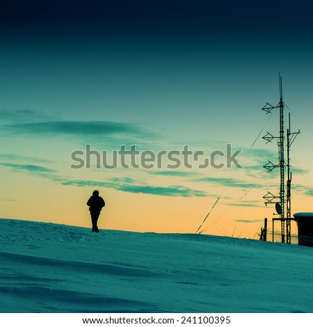 Technical tower radio and meteorological observations in the highlands at sunset - stock photo
