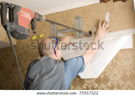 Technician air conditioning. Drill. Work on installing a new air conditioner. - stock photo