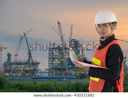 Technician and construction site with cranes on sky background, Power Plant Construction, Lots of tower cranes build large residential buildings at sunrise.