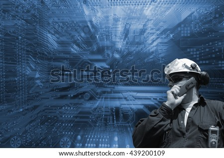 technician and giant computers circuit-board, slight zoom effect on background - stock photo