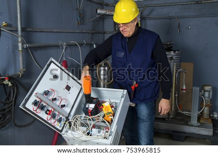 technician at maintenance work with an electric pump