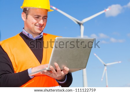 Technician Engineer in Wind Turbine Power Generator Station - stock photo