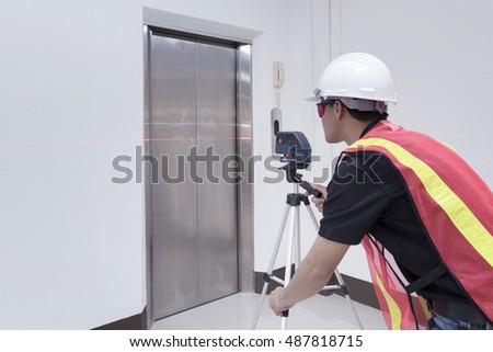 Technician - Engineer investigate Laser Level and safety. Surveyor equipment tacheometer or theodolite at construction site.