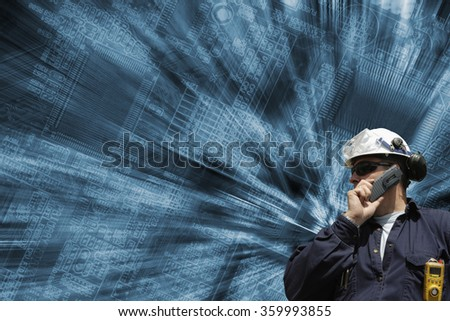 technician, engineer, with computers circuitboard in background, slight zoom effect - stock photo
