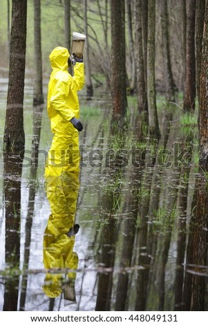 technician examining sample of water in floods area - stock photo