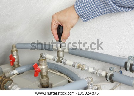 Technician fixing central heating system - stock photo